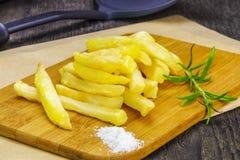 Frensh dłoniaki z rozmarynami na stole Zdjęcia Royalty Free