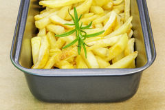Frensh fries with rosemary in dish Stock Photos