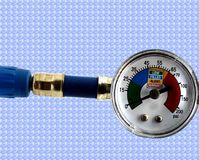 Freon Gauge. For auto air conditioner service on a sky blue background Royalty Free Stock Photo