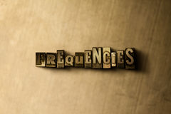 FREQUENCIES - close-up of grungy vintage typeset word on metal backdrop Stock Photo