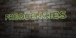 FREQUENCIES - Glowing Neon Sign on stonework wall - 3D rendered royalty free stock illustration Stock Photography