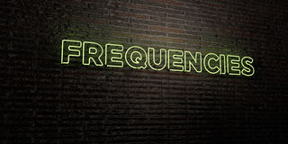 FREQUENCIES -Realistic Neon Sign on Brick Wall background - 3D rendered royalty free stock image Royalty Free Stock Photo