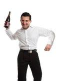 Frequentatore del partito con la celebrazione della bottiglia di vino Fotografia Stock Libera da Diritti