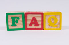 Frequently Asked Questions. Wooden Alphabet Blocks spelling FAQ the commonly used abbreviation of Frequently asked questions Royalty Free Stock Photo