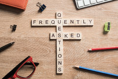 Frequently Asked Questions concept collected of wooden cubes on business workplace stock images