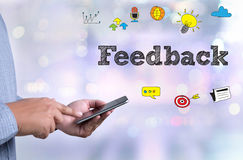 Frequently Asked Questions Faq Feedback  Concept. Person holding a smartphone on blurred cityscape background Stock Images