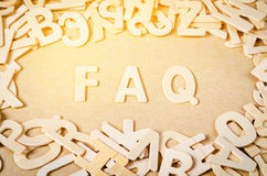 Frequently asked questions. Wood letters as FAQ abbreviation, frequently asked questions on wooden background Royalty Free Stock Photo