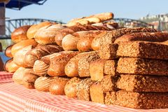 Fres bread at a street marketplace. The variations of the fresh bread displayed at baker stand at street marketplace. Naplavka, riverbank of Vltava river stock photos