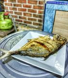 a fresh fish from the sea .. fry it !! stock photography