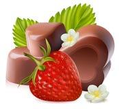 Fresa con las hojas y los caramelos del chokolate. Fotos de archivo libres de regalías