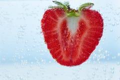 Fresa en el agua Imágenes de archivo libres de regalías