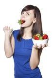 Fresa esting de la mujer feliz joven Foto de archivo