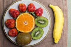 Fresa y plátano anaranjados del kiwi Fotografía de archivo