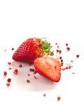 Fresas con los granos de pimienta rojos Imagen de archivo libre de regalías