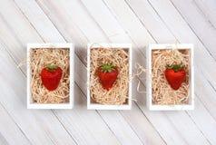 Fresas en cajones Imagen de archivo libre de regalías