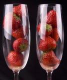 Fresas en vidrios Imagen de archivo