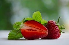 Fresas, una y una mitad Fotografía de archivo libre de regalías