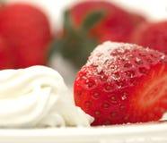 Fresas y crema Fotos de archivo