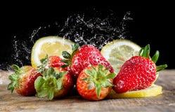 Fresas y limón Imágenes de archivo libres de regalías