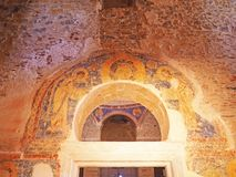 Fresco and arched doorway inside a Byzantine church. A religious fresco around the arched interior doorway of Agia Sofia, a Byzantine church in Monemvasia Stock Photo