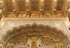 A fresco in the city of Mandawa. A hand painted fresco with a religious scene is painted on the wall of a Haveli in Mandawa, India royalty free stock photography