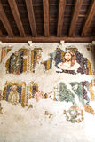 Fresco damaged to be restored in a medieval cloister. Royalty Free Stock Photos