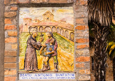 Fresco dedicated to Catholic Blessed on the walls of a church. The fresco represents the meeting of the Catholic Blessed with a man and his suffering son Stock Images