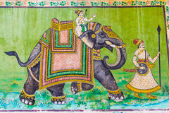 Fresco of an elephant and two warriors Stock Image