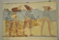 Fresco fragments depicting a procession of male and female figures carring gifts from Knossos Palace. Fresco from Neopalatial period in the Minoan Archaeological stock photography