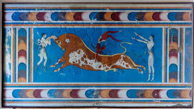 Fresco Minoan Bull Knossos Palace, Crete, Greece. Minoan fresco with people jumping over a bull like in Minoan, Greek and Cretan mythology, Knossos, Crete Stock Photography