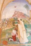 Fresco in Monte Oliveto Maggiore - The Monk Romanus Dresses Benedict. Fresco in the Monastry of Monte Oliveto Maggiore, near Siena, Tuscany, Italy, with a Scene royalty free stock image