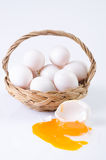 Fresco, ovos na cesta no fundo branco Fotos de Stock Royalty Free
