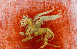 Fresco in Pompeii with winged griffin on a red background Pompeian. Stock Photos