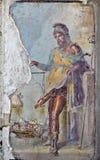 Fresco of Priapus with erect penis, Vettii houses, Pompeii. Stock Photos