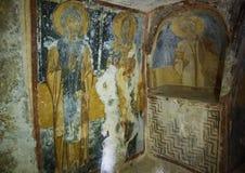 Fresco Saint Benedict, Saint Basil the Great, and Saint Stephen, La Chiesa di San Lorenzo, Parco Rupestre Lama D`Antico. Pictured is a fresco showing left to Royalty Free Stock Image