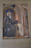 Fresco of Saint Benedict. The fresco of St Benedict of Nursia writing his rules for monastic life can be found within the cell that bears his name in Monte royalty free stock image
