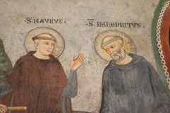 Fresco of Saint Benedict. Saint Benedict and young Saint Maurus in discussion.  The fresco can be found at the San Benedetto monastery in Subiaco. Photo taken Stock Images