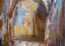 Fresco Saint Stephen, La Chiesa di San Lorenzo, Parco Rupestre Lama D`Antico. Pictured is a fresco showing Saint Stephen in the ancient cave church, La Chiesa di Stock Photo