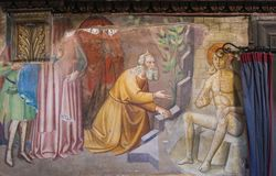 Fresco in San Gimignano - Book of Job. Renaissance Fresco depicting Job, plagued by boils, visited by his friends, in the Collegiata of San Gimignano, Italy Royalty Free Stock Photography