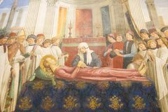 Fresco in San Gimignano - The Funeral of Saint Fina. Fresco & x28;1477& x29; of The Funeral of Saint Fina by Domenico Ghirlandaio in the Collegiata of San Stock Images