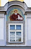 Fresco of a shepherd with a lamb. And the inscription pascite oui in vobis est gregem dei above a easter decorated window, Freistadt, Austria Royalty Free Stock Image