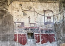 Fresco wall of house in Parco Archeologico di Ercolano. Pictured is a fresco covering a wall in a house in the Parco Archeologico di Ercolano. The archaeological Royalty Free Stock Photography