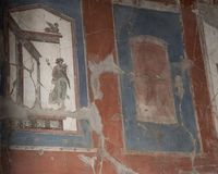 Fresco wall of house in Parco Archeologico di Ercolano. Pictured is a fresco covering a wall in a house in the Parco Archeologico di Ercolano. The archaeological Stock Photo