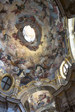 The frescoed interior of the church in Alba, Italy. Alba,Piedmont,Italy,Europe - May 3, 2016 : The frescoed dome of Santa Maria Maddalena Church Royalty Free Stock Images