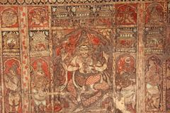 Frescoes and ancient drawings paintings and scenes on the ceiling in Shiva Virupaksha Temple. Ancient terracotta patterns.  stock photography