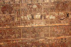 Frescoes and ancient drawings paintings and scenes on the ceiling in Shiva Virupaksha Temple. Ancient terracotta patterns.  royalty free stock image