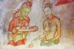 Frescoes at the ancient rock fortress of Sigiriya Sri Lanka. UNESCO Royalty Free Stock Photo