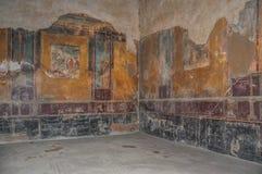 Frescoes in a Roman villa, Pompeii. POMPEI, ITALY - SEPTEMBER 10 2013: Frescoes in a Roman villa royalty free stock image