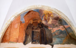 Frescoes with scenes from the life of St. Francis of Assisi. The frescoes with scenes from the life of St. Francis of Assisi, cloister of the Franciscan Stock Photo