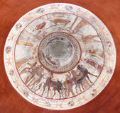 Frescoes In Tomb Of Thracian King. Dome of the tomb of a thracian king decorated with frescoes such as a funeral feast and chariot race Stock Image